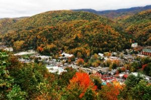 The city of Gatlinburg in the mountains during the fall.