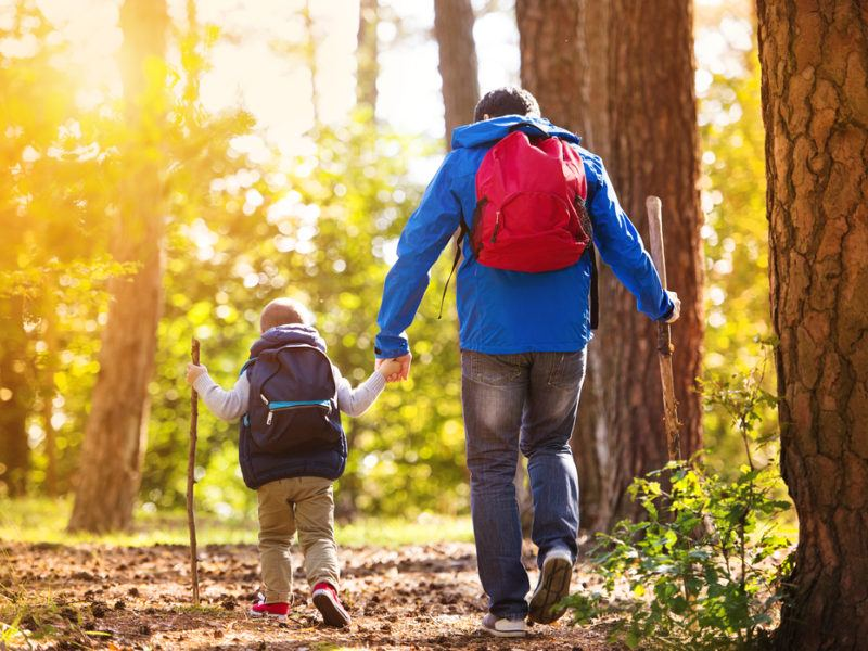 Man hiking with young child