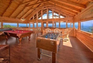 gatlinburg cabin with game room featuring a pool table, foosball, air hockey, and a view of the Smoky Mountains